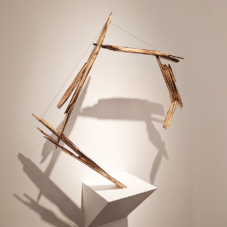 Untitled | burned pine wood, braided steel cable | 35 x 35 x 3 inches